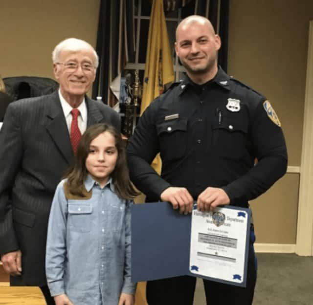 Harrington Park Mayor Paul Hoelscher, patrolman James LaVigna and the 10-year-old boy who he saved in December.