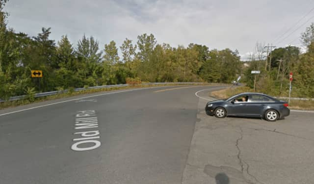 A two-car crash has closed down Old Mill Road.