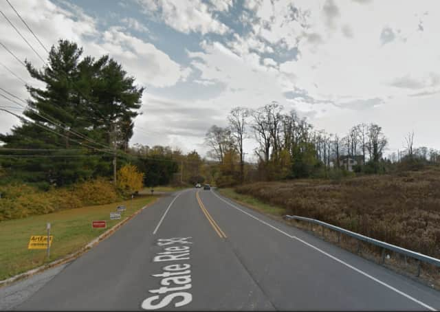 A man said he was hit by a car while riding his bike on Route 55.
