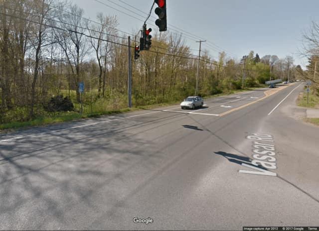Spring Road is closed in the Town of Poughkeepsie following a car crash.