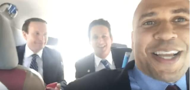 Sens. Chris Murphy of Connecticut, Brian Schatz of Hawaii and Cory Booker of New Jersey broadcast on Facebook Live from inside a cab.