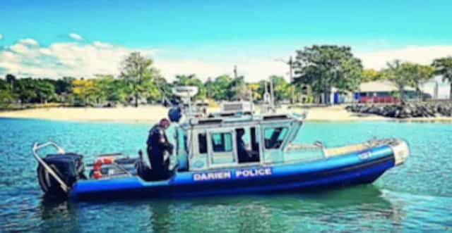 Darien marine police responded after a sailboat hit an anchored boat in Long Island Sound.