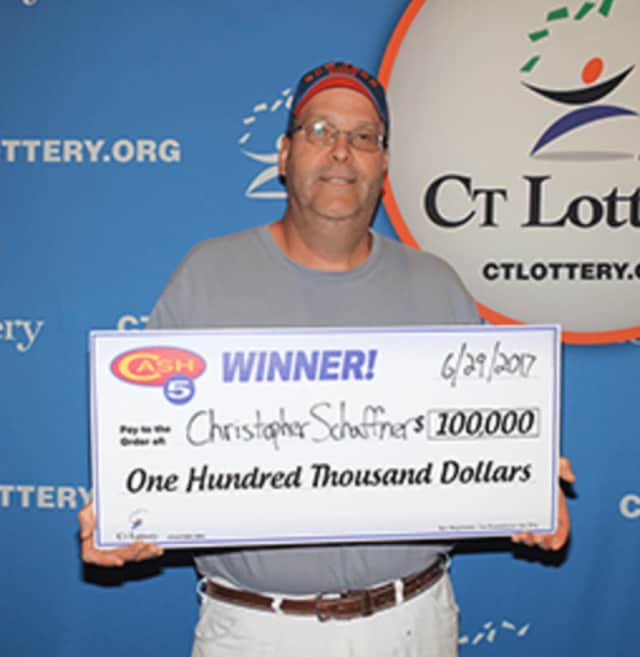 Christopher Schaffner celebrates his Cash5 top prize of $100,000.