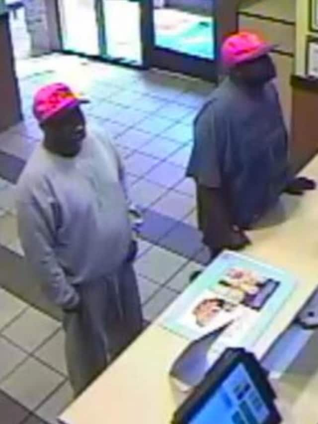 Surveillance photos show the two male suspects who robbed the Sonic in Milford.