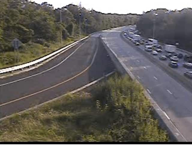 A look at heavy southbound traffic while all lanes are closed northbound on I-95 at Playland Parkway just after 7 p.m. Tuesday.