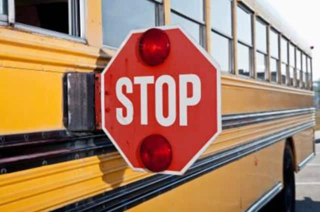 A school bus monitor was charged with striking and threatening an 11-year-old.