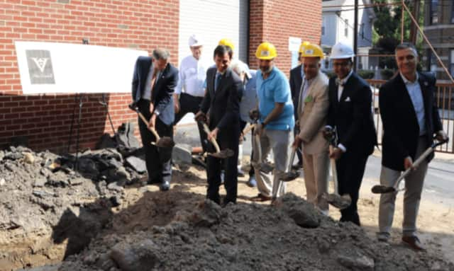 Officials breaking ground at the V Hotel in New Rochelle.