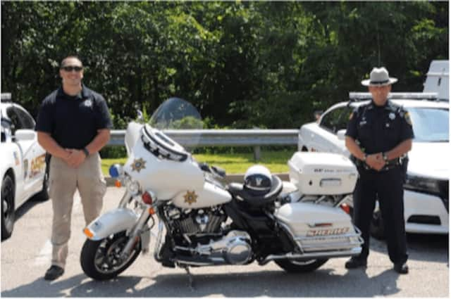 Members of the Putnam County Sheriff's Office Motorcycle Unit, with new motorcycle dedicated to the memory of deceased Senior Investigator Mark R. Gilmore.