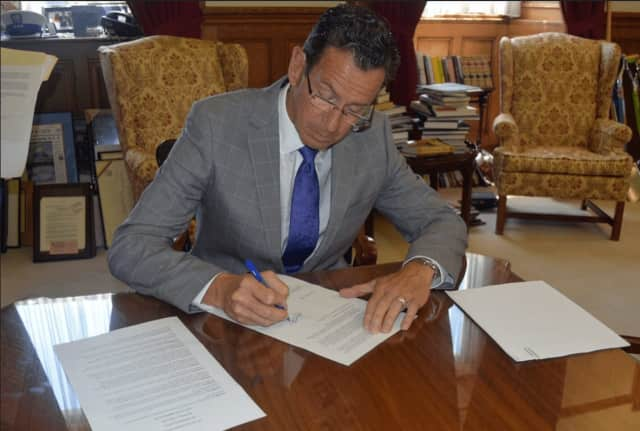 Gov. Dannel Malloy signing Executive Order No. 60 on Wednesday.