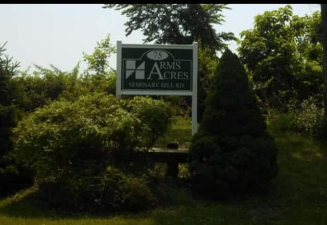 A woman at Arms Acres was charged with assault following a disagreement.