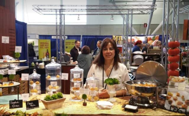 Co-owner Sonia Wells poses with some of Saugatuck Kitchens' delectable appetizers.