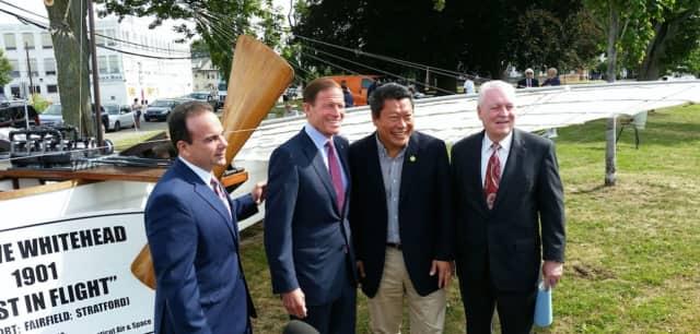 Bridgeport Mayor Joe Ganim, U.S. Sen. Richard Blumenthal,  state Sen. Tony Hwang and Fairfield First Selectman Mike Tetreau stand before a replica of Whitehead's aircraft.