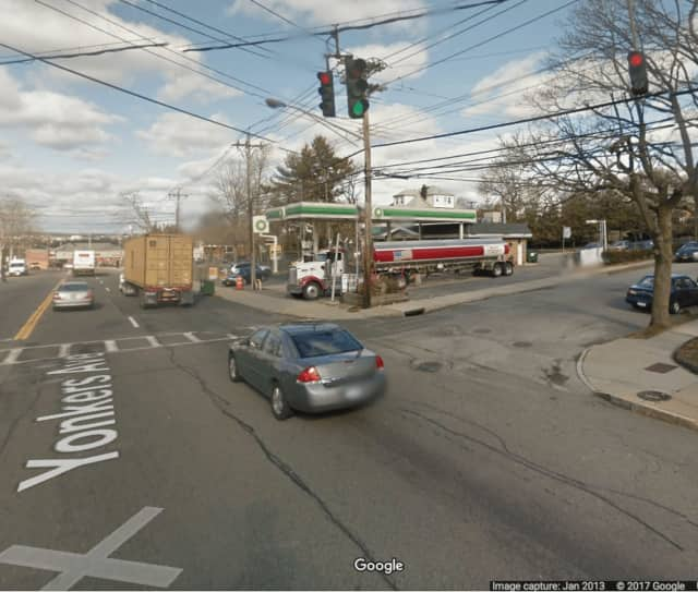Yonkers police are searching for two armed men who robbed a gas station.
