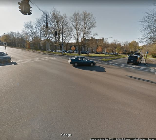 A woman on a bike was hit by a car that fled the area.