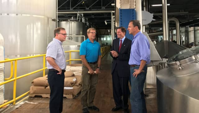 Stratford Mayor John Harkins joins U.S. Sen. Richard Blumenthal for a tour of Two Roads Brewery.