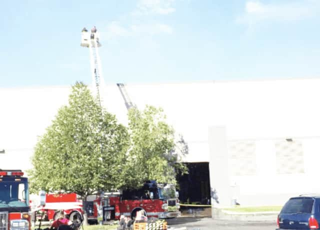 Firefighters dousing hot spots at the fire at the Gap Inc. clothing distribution center in Fishkill last year.