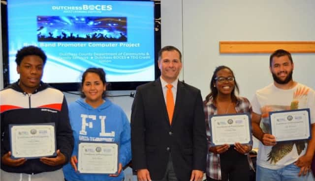 Students in the Youth Financial Literacy & Computer Training Program are congratulated by County Executive Marc Molinaro.
