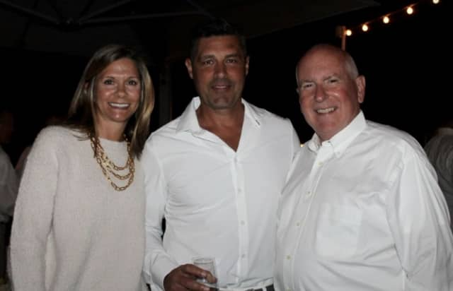 Westport First Selectman Jim Marpe, right, poses with partygoers at the Summer Soirée at Pearl at Longshore.