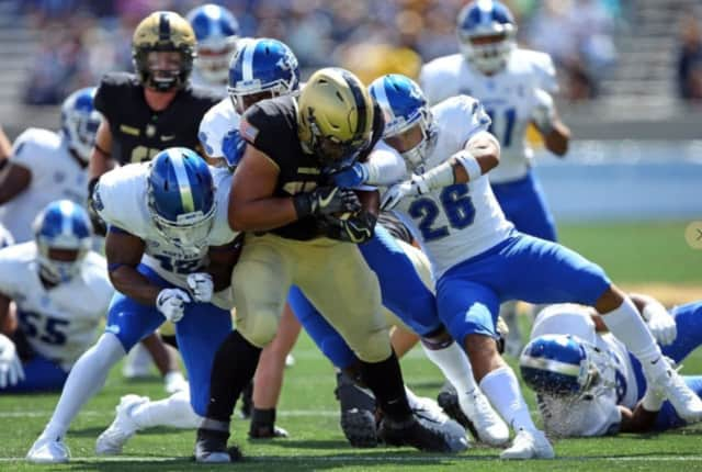 Darnell Woolfolk and Army's triple option wore down Buffalo's defense in the fourth quarter.