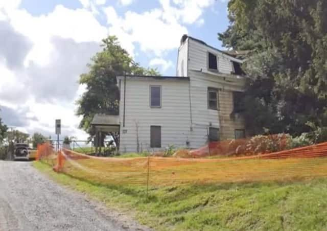 A home near Brown's Pond Reservoir was demolished on Monday.