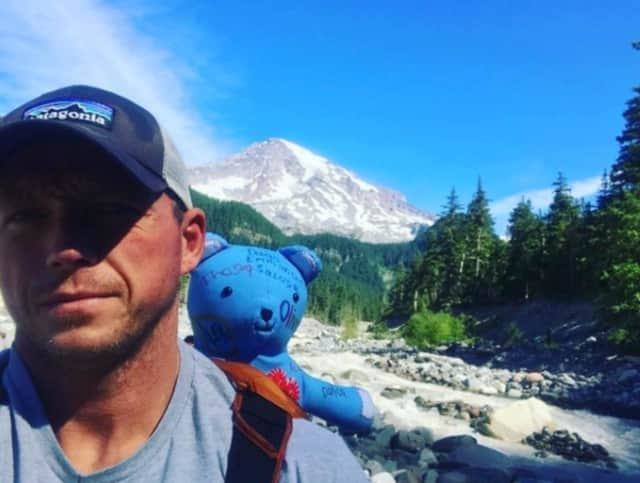 Lyndhurst Police Officer Tom McSweeney and Rainy The Bear climb Mount Rainer in Washington.