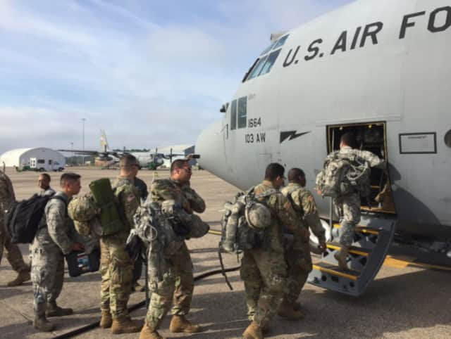 Members of the Connecticut National Guard board a cargo plane Tuesday for Puerto Rico, where they will help establish a communications infrastructure.