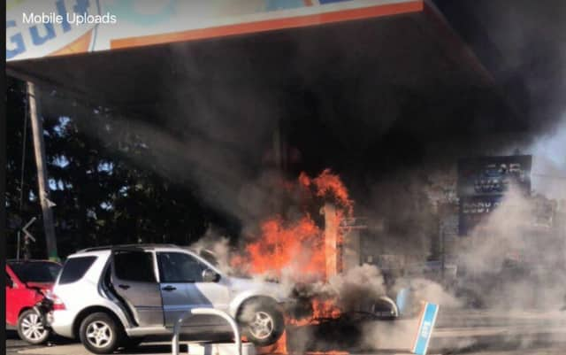 An SUV slammed into gas pumps on N. Main St., in Spring Valley, causing a large fire.
