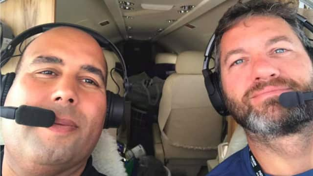 Paul Weismann, right, of Westport, flies his Cessna Citation to Puerto Rico to deliver supplies  in the wake of Hurricane Maria.