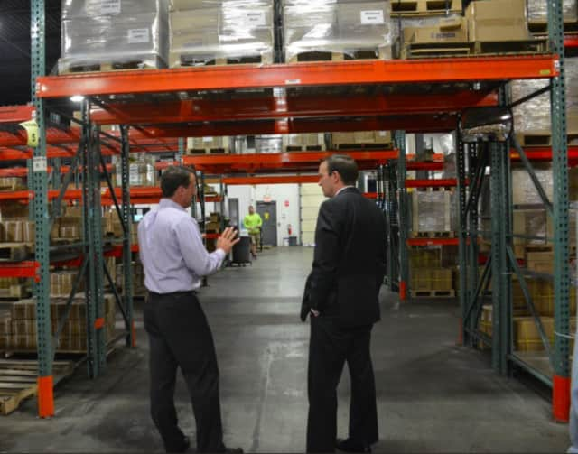 U.S. Sen. Chris Murphy‏ tours the warehouse for Wind Hardware in Newtown on Friday.