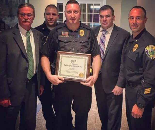 Fairfield Officer Mark Letsch, center, is surrounded by (left to right): Deputy Chief Chris Lyddy, Sgt Mike Paris, Chief Gary MacNamara and Lt. Robert Kalamaras.