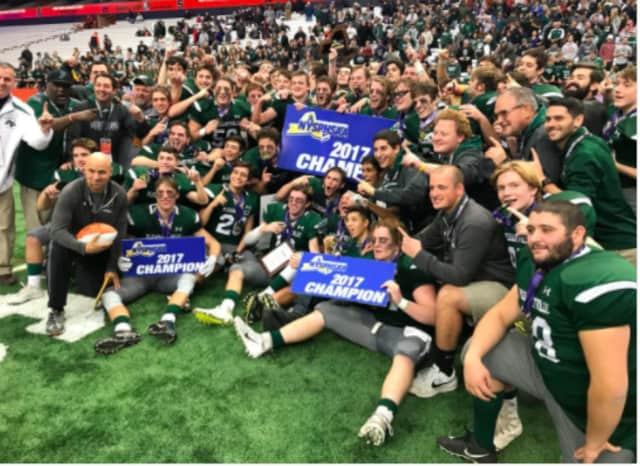 Pleasantville players and coaches celebrate the state championship.