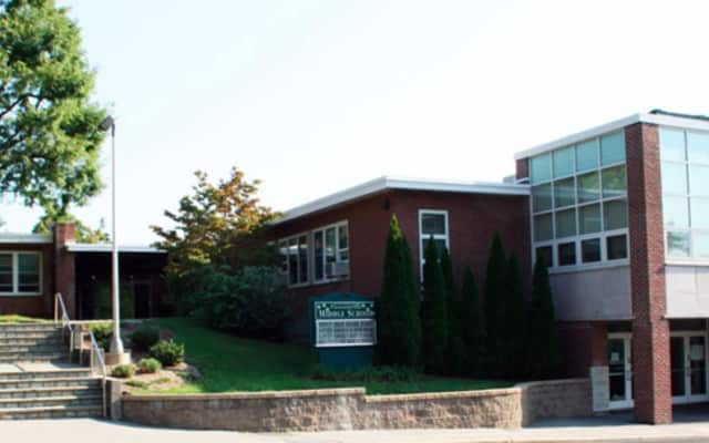 A student at Pleasantville Middle School mother is claiming his father is 'radicalizing' him.