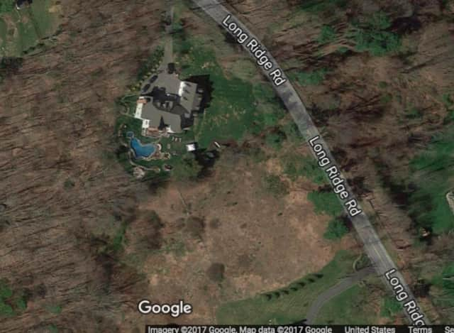 The body was discovered by a homeowner at 496 Long Ridge Road in Pound Ridge.