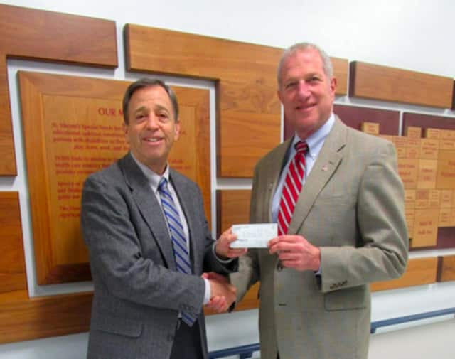 Shelton Mayor Mark Lauretti, right, hands a check for $5,000 to Kennendy Center CEO Martin Schwartz.