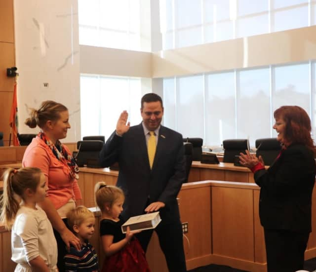Steve Neuhas being sworn in for his second term.