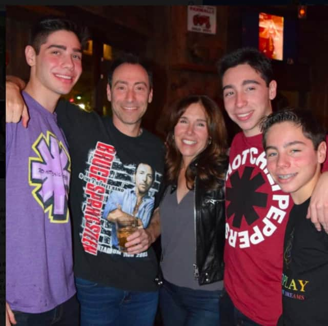 Bruce and Irene Steinberg and their sons, Matthew, William and Zachary of Scarsdale. Bruce, second from left, was an executive at Bridgewater Associates in Westport.
