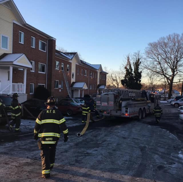 Norwalk firefighters make quick work of a fire at Carlton Court on Wednesday morning.