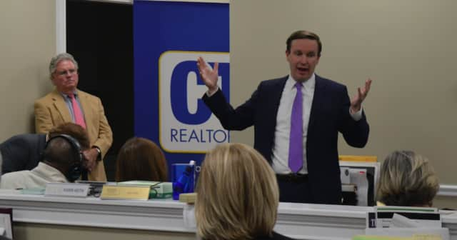 U.S. Sen. Chris Murphy took questions about the crisis in Puerto Rico at a community forum on the new federal tax bill Friday in Fairfield.