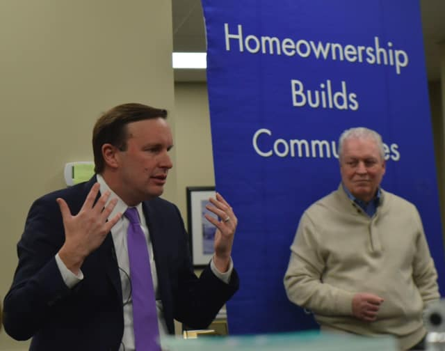U.S. Sen. Chris Murphy, left, and Fairfield First Selectman Mike Tetreau discuss new federal tax law with real estate agents and homeowners in Fairfield Friday.