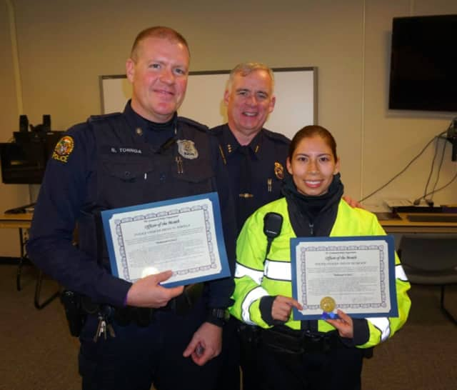 Greeniwich Police Chief Jim Heavey, center, with Police Officers Brian Tornga, left, and Siuyan Su Ah Sor.