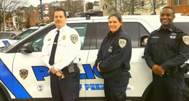 Proudly showing off their Autism Awareness Uniform Patches and Police Patrol Vehicle Decals are Peekskill Police Chief Halmy, Officer Sgroi and Officer Woodland.