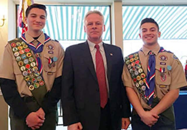 Eagle Scouts Gregory Yovane, left, and Jason Garofalo, right, with Putnam County Undersheriff Michael F. Corrigan.