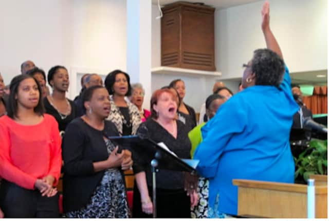 Earlena Thevenin-Green leading the Antioch Baptist Church Choir.