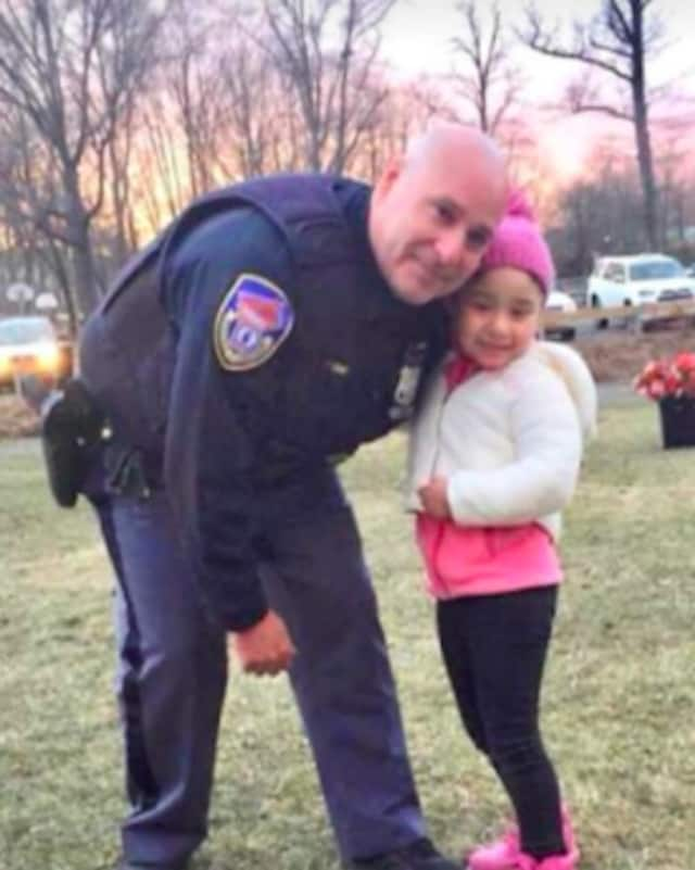 Westchester County Police Officer Efrain Rivera with a young member of the Mount Kisco community.