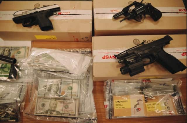 "Some of the cash and weapons seized as part of ""Operation Yellow Brick Road."""
