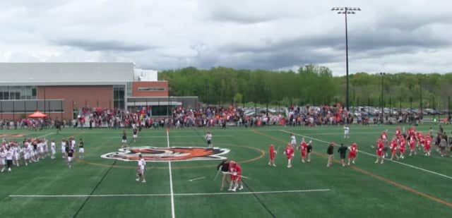 Wesleyan players celebrate their 19-18 upset win over No. 1-ranked RIT in the NCAA Division III semifinals on Sunday.