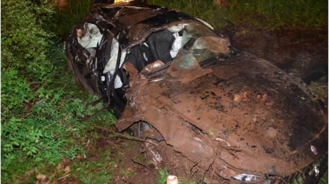 Photos released by state police shows the heavily damaged Maserati.