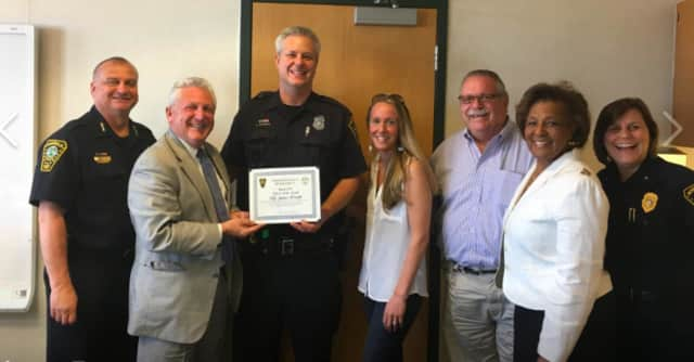 From left, Norwalk Police Chief Thomas Kulhawik, Mayor Harry Rilling, Officer Jamie Wright with his fiancee, Kelly, Commissioner Charlie Yost, Commissioner Fran Collier-Clemmon and Deputy Chief Susan Zecca.