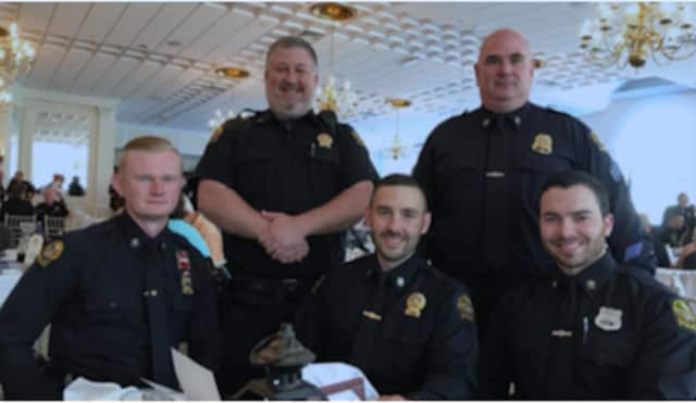 Greenwich Police officers honored at a MADD event for their work.