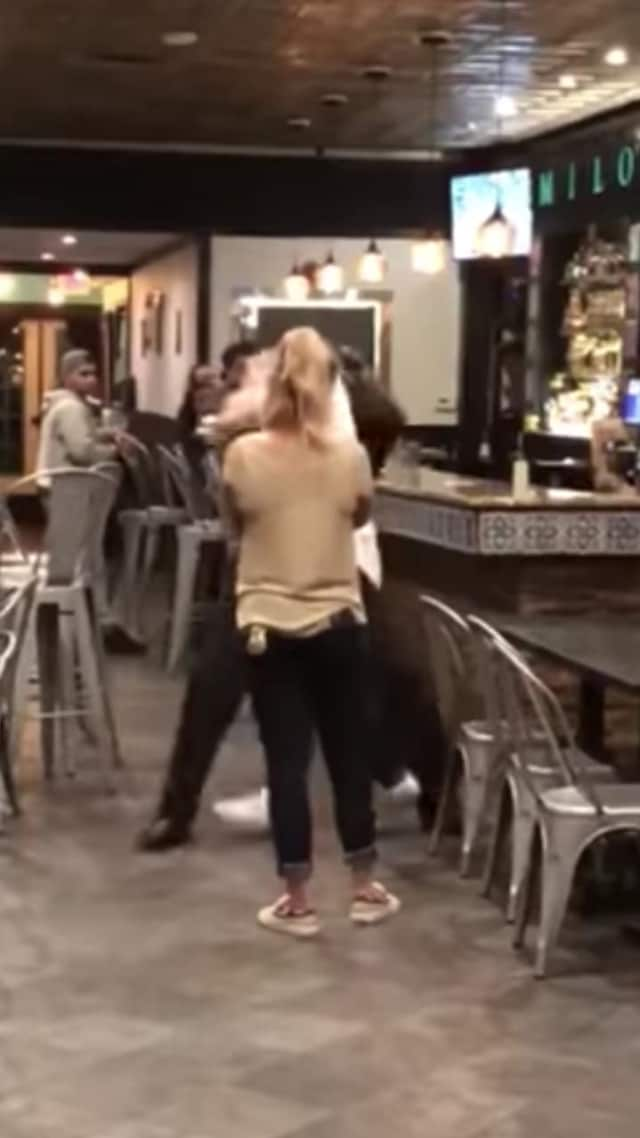 A bouncer at Milo's Cantina in Poughkeepsie was caught on camera during an incident with a patron.